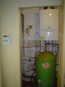 New Vaillant ecoTEC 624 boiler mounted in cupboard with existing cylinder