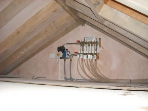 Heating manifold hidden in ceiling area