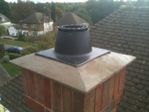 New Viessmann roof terminal being installed, new mortar rendering